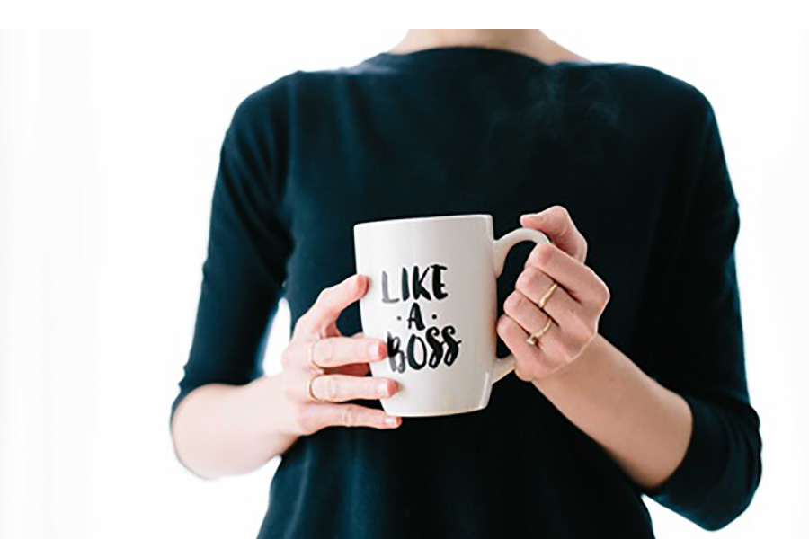 Woman with coffee mug that says Like A Boss.