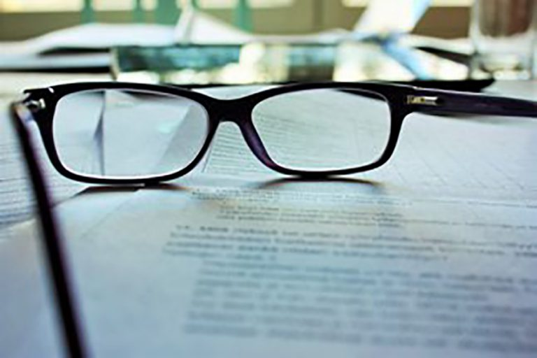 Reading glasses on top of a document