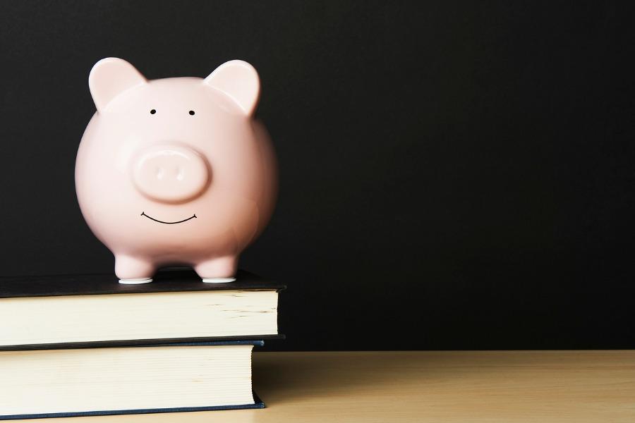 Piggybank on top of books