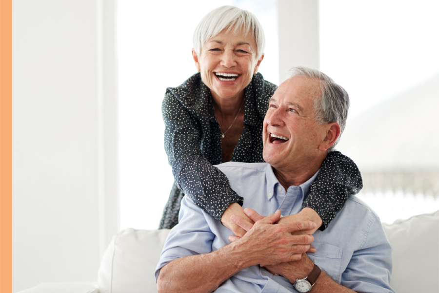 Retired Couple Smiling After Retirement Planning